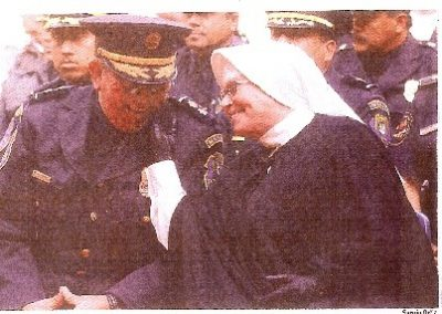 """Portese bien, muchachito"" – ""Behave well, young man"" - Mother Antonia & police – circa 1990"