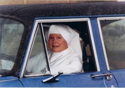 Mother Antonia in her 1979 blue Checker 12-seater taxi – 1987